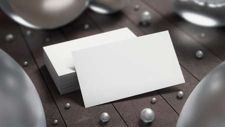 Creative white business card on the wooden background with glass spheres. 3D render illustration.