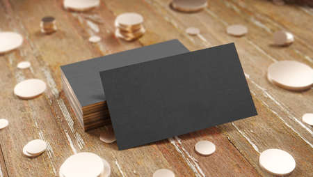 Creative black business card on the wooden background with gold coins. 3D render illustration. Stock fotó