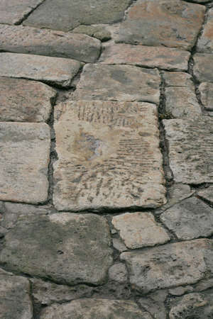 Ancient roadway laid out by the big stone plates photo