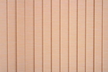 The closed window blinds. Vertical, fabric, wide, pink