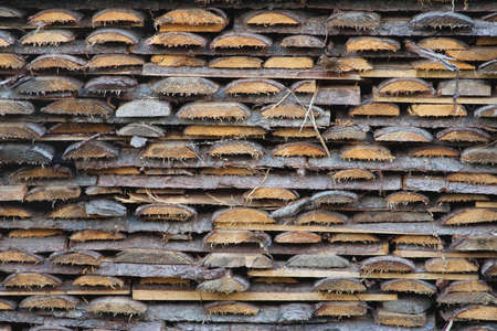 neatly stacked: Sawn and neatly stacked pile of pine boards. Texture, background Stock Photo