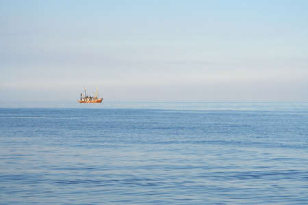 mining ship: Fishing boats while fishing in the evening sea Stock Photo
