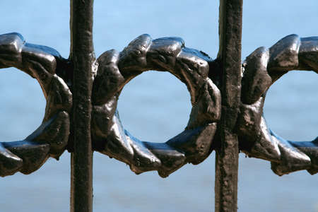 Detail of cast iron ornamental fencing riverbank black
