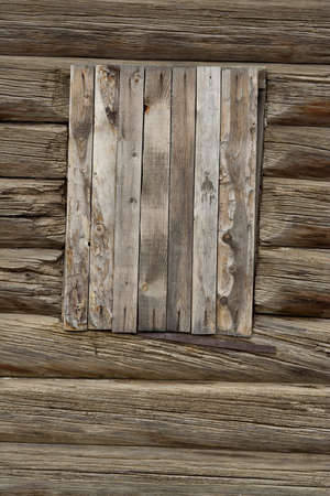 Boarded-up window of an old country house. Texture, background
