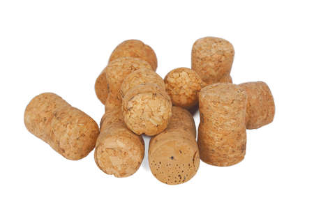 disarray: Wine corks lying in disarray on a white background Stock Photo
