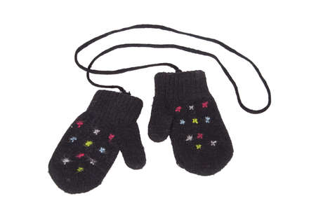 Black wool knit baby mittens on a string Stock Photo - 8620624