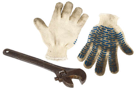 Old, metal monkey wrench and gloves, working on a white background  photo