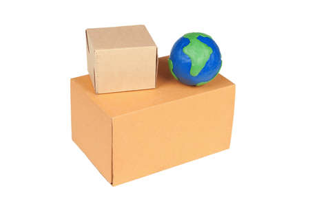 Two packing boxes and model of the globe on a white background Stock Photo - 8888187