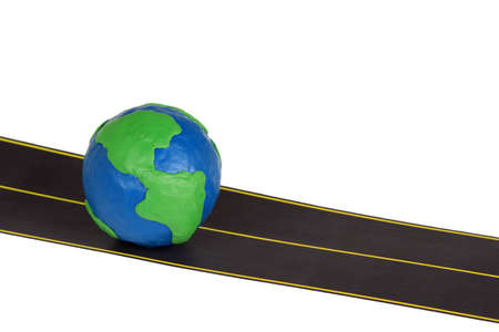 Plasticine model of earth and automobile highway  photo