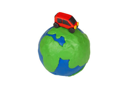 Plasticine globe and a car on a white background  Stock Photo