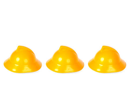 ranked: Ranked on a white background, yellow fire helmets Stock Photo