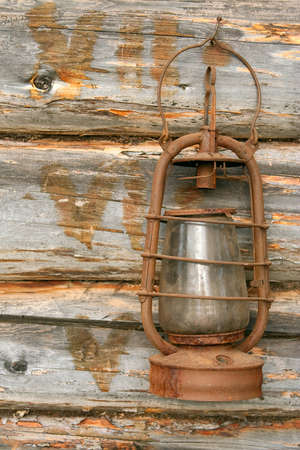The old kerosene lamp hanging on the wall of a village house Stock Photo