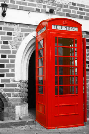 Red telephone booth in the old city street
