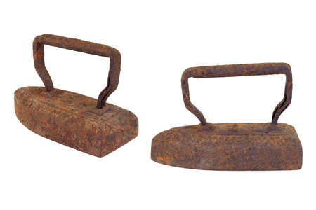 Old, rusty metal irons on a white background Stock Photo - 11556587