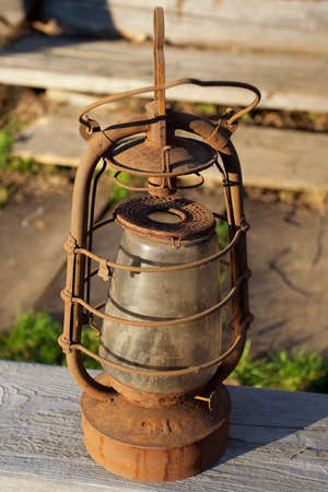 Antique kerosene lamp on the background wall of a village house Stock Photo - 12873070