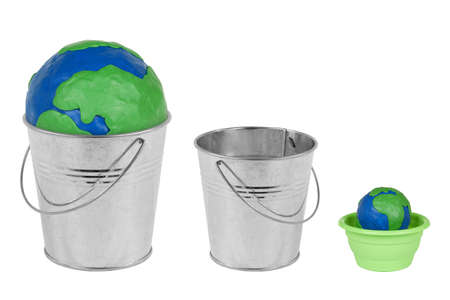 Two metal buckets, flower pot and a globe on a white background photo