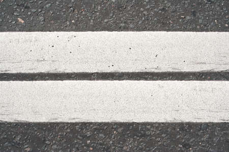 intermittent: Road asphalt with white markings  The texture of the background