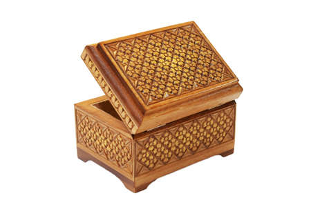 Wooden casket decorated with carvings, standing on a white background Stock Photo - 13949912