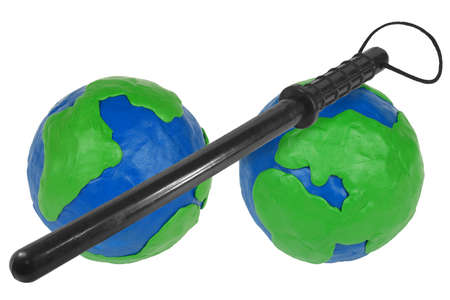 Two clay hemisphere and police baton on a white background Stock Photo - 14425851