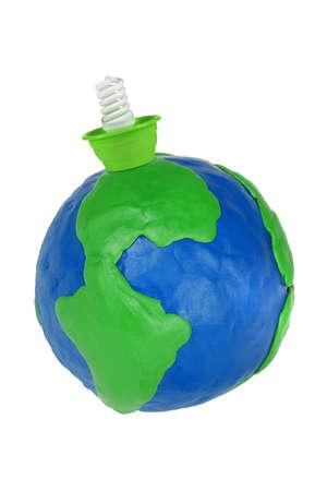 The electrical energy-saving lamp and plasticine Globe photo
