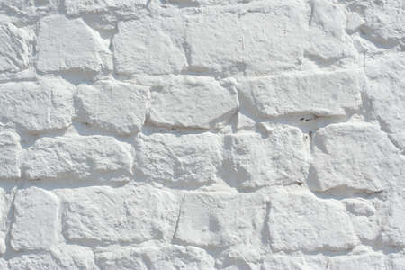 A fragment of an old brick wall white  The texture of the background Stock Photo - 14698053