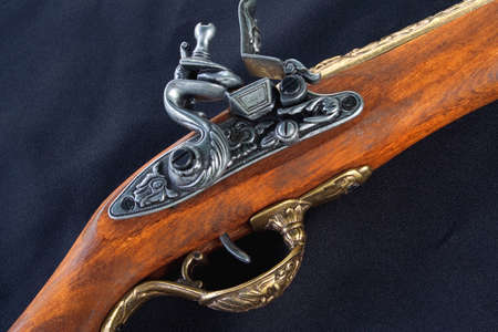 The fragment model pistol lying on a black background photo