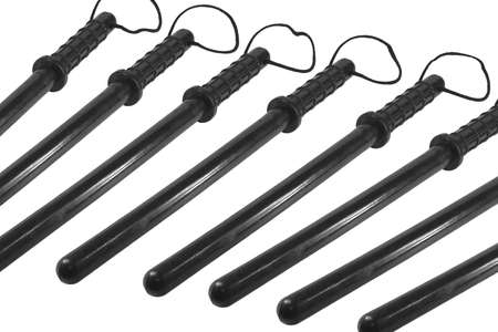 Black rubber batons on a white background