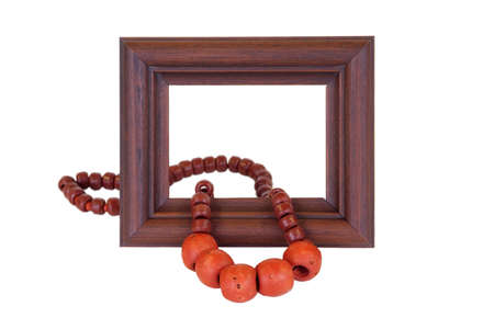 Wooden frame and ceramic beads, lying on white background photo