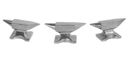 Silver miniature anvil on a white background  Model, isolated photo