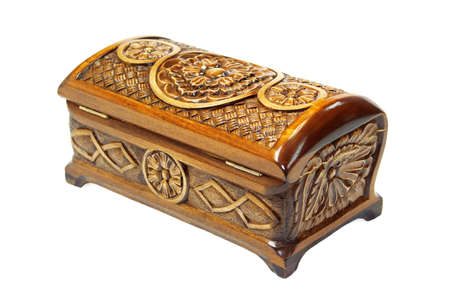 Wooden casket decorated with carvings, standing on a white background Stock Photo - 17813795