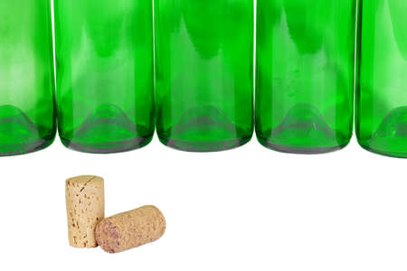 Empty wine bottles in a row and wine corks photo