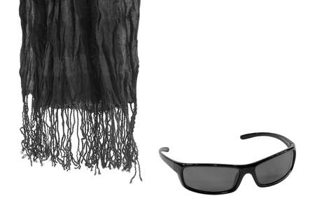Black scarf and sunglasses on a white background photo