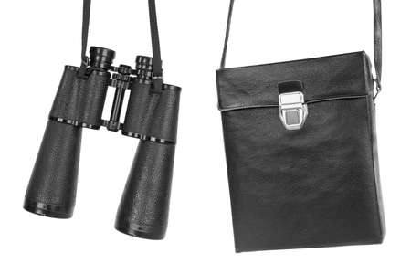 Modern binoculars and leather bag for storage photo