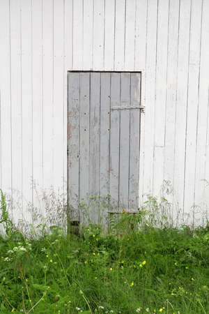 Closed door and wall fragment of the old house Stock Photo - 21992834