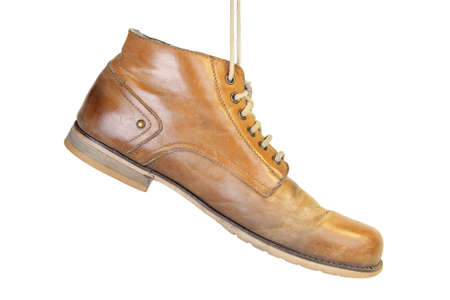 stoking: Old leather shoes hanging on a cord  Subject isolated