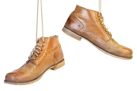 stoking: A pair of old leather boots with laces hanging