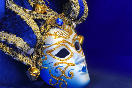 Festive carnival mask on the background of blue cloth