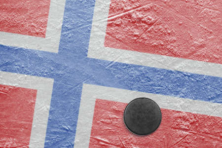 Washer and the image of Norwegian flag on a hockey rink photo