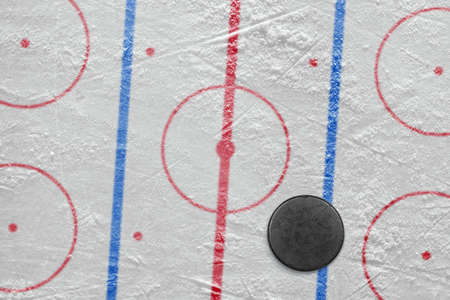Puck lying on the ice hockey rink  Concept Stock Photo