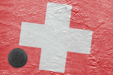 Washer and flag image Switzerland on a hockey rink photo