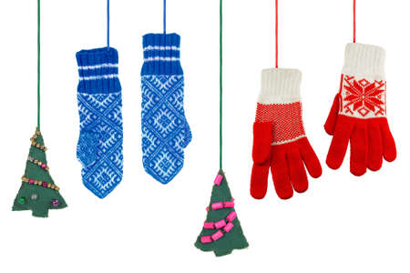 Two pairs of knitted, woolen mittens and Christmas tree toy  photo