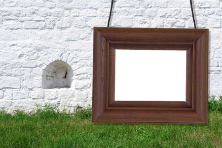 Wooden frame with a white background on the background of the wall photo