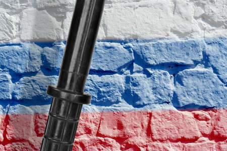 Baton on the background image of the Russian flag