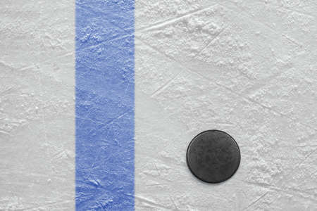 Puck lying on a hockey rink  Texture, background photo