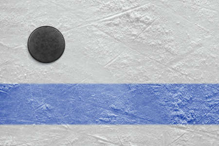 Puck lying on a hockey rink  Texture, background