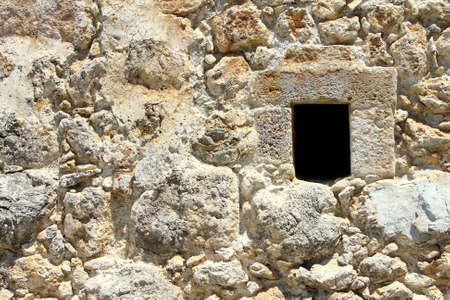 Fragment of the old fortress wall with a window  Texture, background  photo