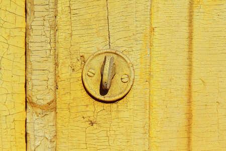 Door lock and a fragment of an old wooden door   photo