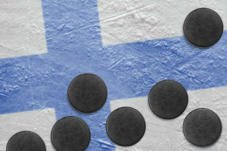 Washers and the image of the Finnish flag on a hockey rink photo