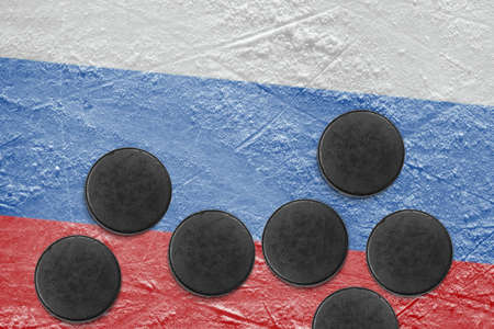 Washers and the image of the Russian flag on a hockey rink photo