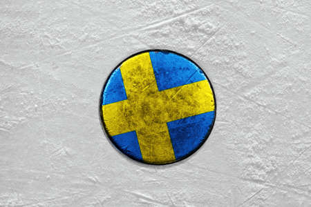 Washer with the image of the Swedish flag on a hockey rink photo
